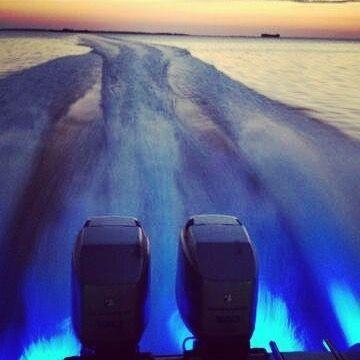 Blue LED boat lights at sunset.