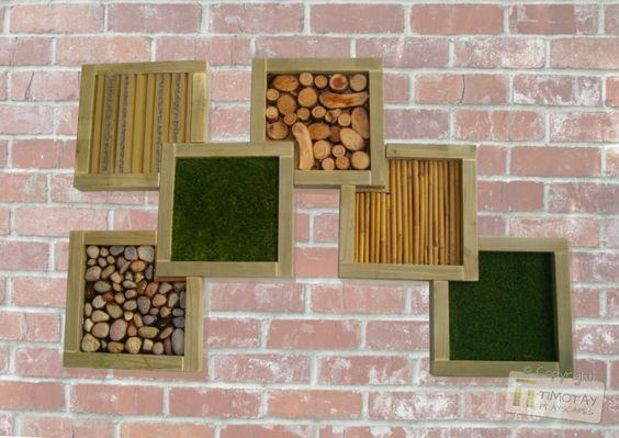 Different textures framed in a sensory garden; I have includes these different framed textures in my sensory board as they incorporate the idea of exploring textures for both the visually impaired as well as whose who are not. The overlapping frames allow