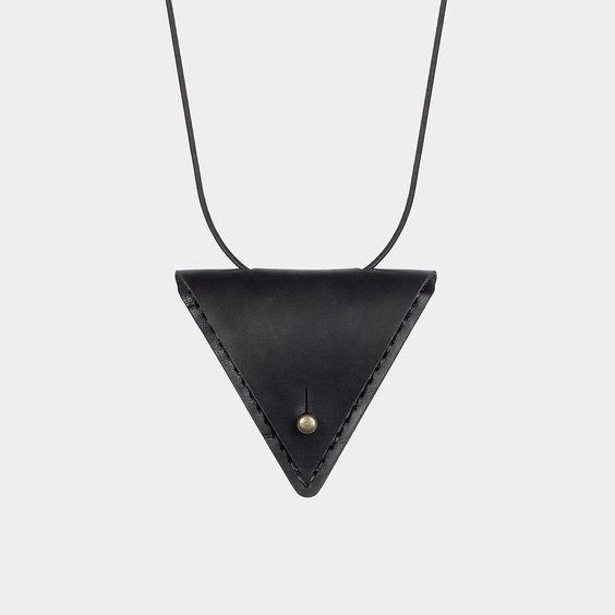 Our take on the traditional amulet pouch worn for protection and security, our unisex Amulet necklace can be worn alone or filled with a favorite treasure, talisman, or anything small you'd like to ke