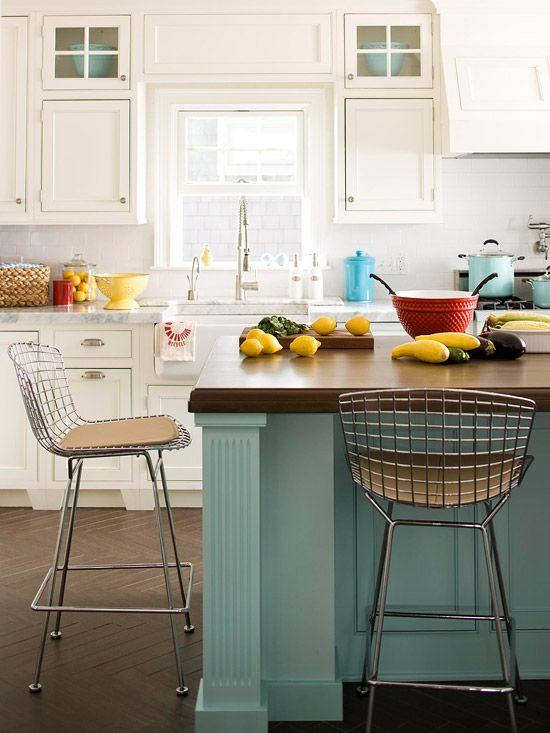 pretty white kitchen with painted island and wood top - love those bar stool chairs!