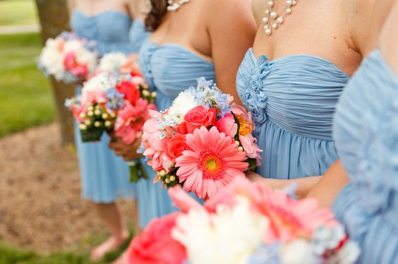 Gerbera peonies roses with delphanium and white accents against blue dresses