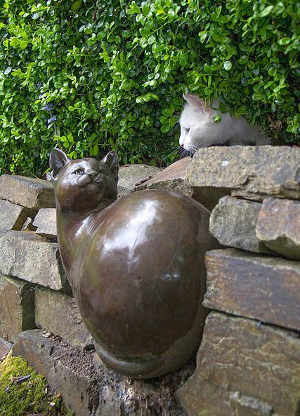 Cat with a Georgia Gerber cat bronze statue: