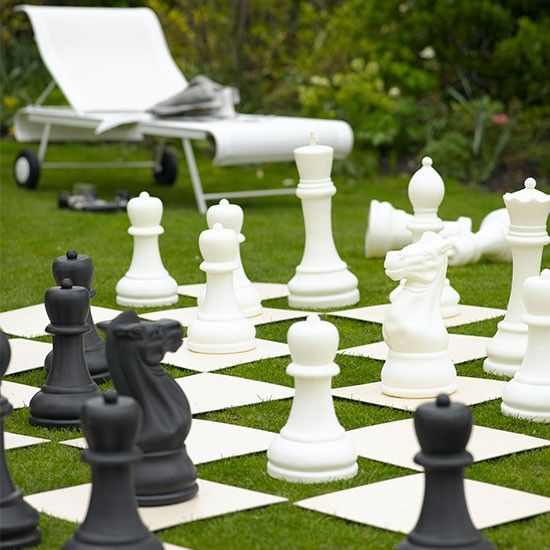 Garden with giant chess set Modern garden design ideas Garden