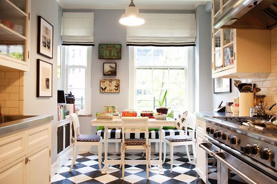 black and white floor, blue walls kate spade's kitchen