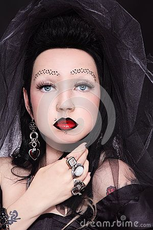Gothic lady by Olga Ekaterincheva, via Dreamstime