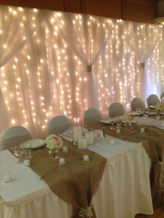 I like the burlap & flower tie at the front instead of it being the runner down the length of the table!