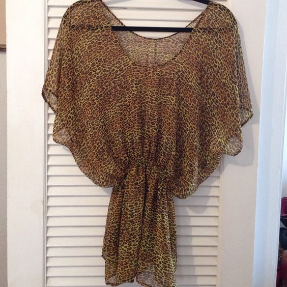 Leopard print cover up Sheer, flowy, leopard print cover up with elastic waistband. Swim Coverups