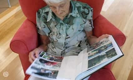 Dementia activity: Creating a memory book- This could also be done with digital storytelling apps.