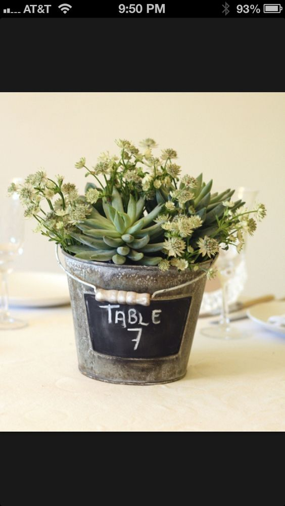 A small bucket can also be nice idea for table