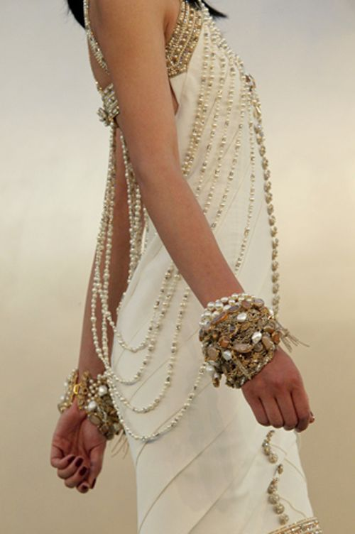 pearls on her dress and wrist- sexy look