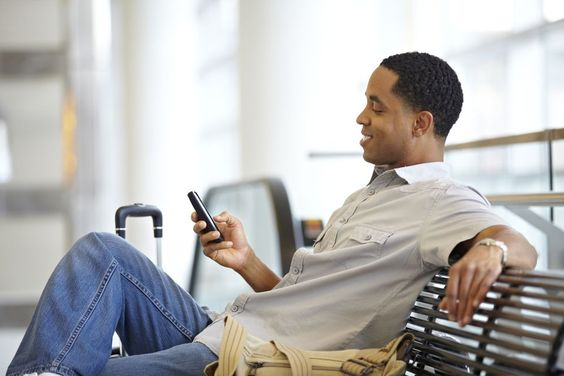 Man using his cellphone in airport