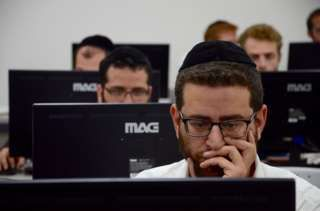 Haredi schools do not teach math, science or English. Haredi men are expected to spend most of their time studying the Torah and Talmud, Judaism's sacred texts, leaving their wives to go out and work. About half of Israel's Haredi men live this way. But while the cost of living has risen in recent years, child benefit has been cut - bad news for Haredi families, which often have eight-to-10 children and rely on benefits to make ends meet.