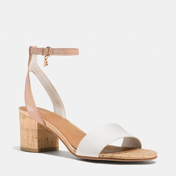 Smooth, polished calf leather makes a striking contrast with the rustic look of natural cork on this refined, leather-soled sandal. Barely-there straps balance a chunky block heel, while tiny, polished charms finish the design with a dainty bit of whimsy.