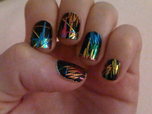 I think this is a sticker, but I would love to try this on my own with real nail polish.