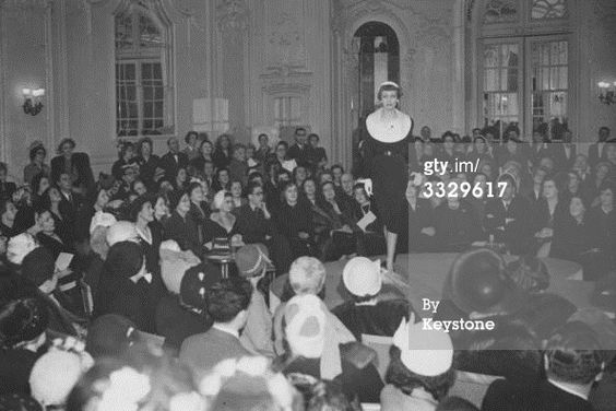 News Photo : Guests watching a fashion show of a collection by Christian Dior. April 22, 1950  Hulton Archive Photographer: Keystone/Stringer