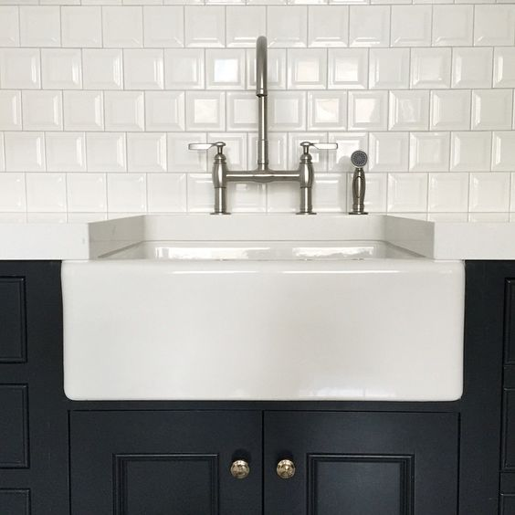 Kitchen Farmhouse Sink With Square Subway Tile And Navy Cabinets