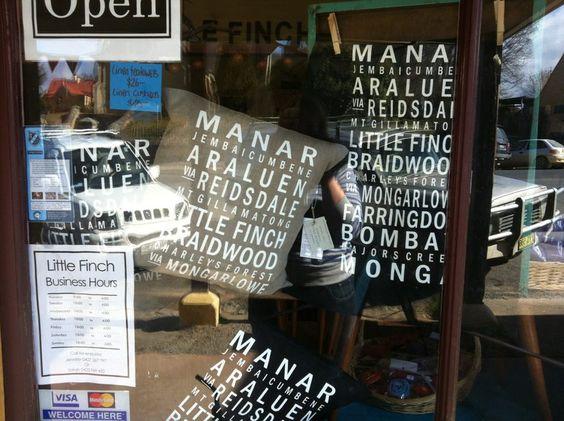 Our. Custom Bus Scroll cushions in the window of Little Finch, Braidwood.