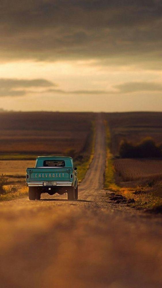 Pickup truck on the dusty desert open road.