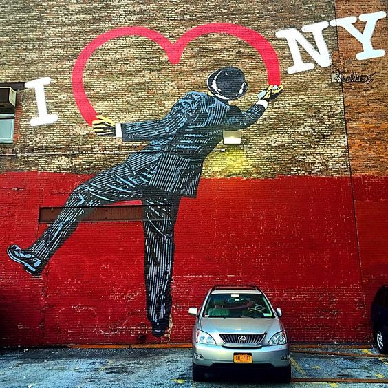 NYC❤️. Finally stumbled across this amazing mural in this parking lot. Love how today there's just the one car and it looks like he's balancing himself around it.