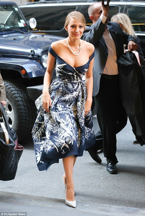 Five times the charm: For the 5th outfit, Blake showed off her cleavage in this classy navy blue and white outfit: