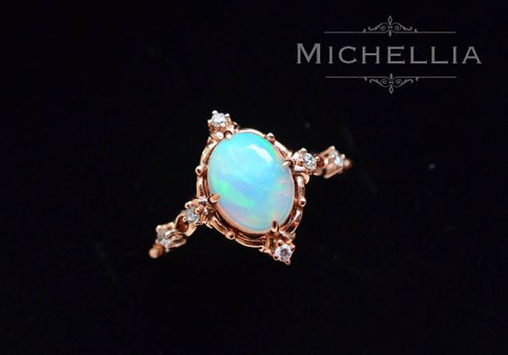 Victorian-inspired rose gold Opal and diamond ring. This is perfection.  It reminds me of the North Star. Could be a right-hand ring