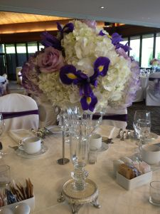 Pretty crystal swags added just the right amount of sparkle to hydrangea and iris centerpieces