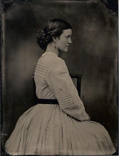 Re-enactor, 1860s -wonderful hair style with braids on the sides - also has belt, pretty drop earrings.: