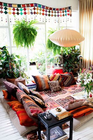 """Beautiful room. Love the plants and the idea of a """"floor mat/sofa"""" And all the pillows..."""