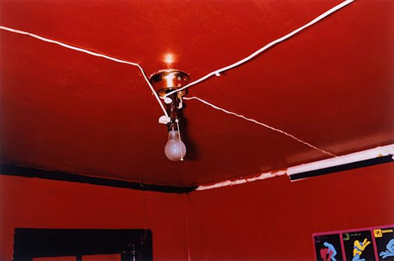 """William Eggleston - The Red Ceiling (1973).    Also known as Greenwood, Mississippi, 1973 after the location and year it was taken, The Red Ceiling has been described as Eggleston's """"most famous photograph,"""" with """"some indefinable sense of menace"""". It is widely recognised as the album cover for the record Radio City by the Memphis band Big Star."""