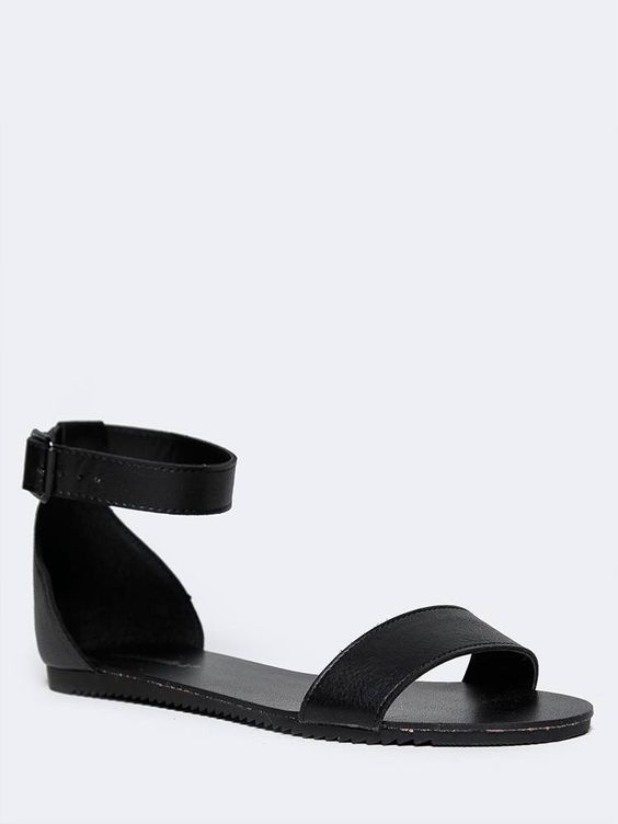 - No wardrobe is complete without these minimalistic ankle strap sandals! - Versatile flat sandals are made out of vegan leather with an open toe design and buckle closure on the side. - Non-skid sole