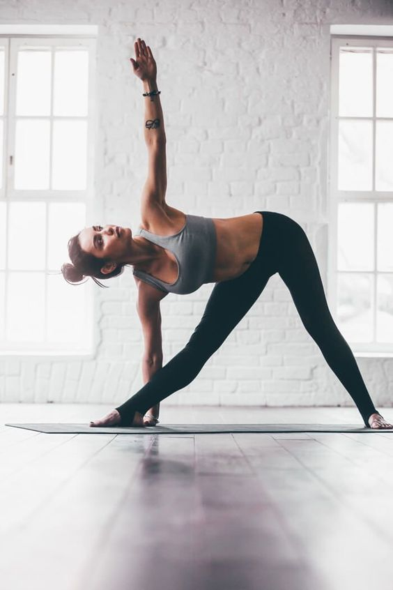 Yoga for Restless Legs: 8 Poses That Will Give You Some Relief | Triangle pose is one of my favorite yoga poses for beginners. Which yoga pose for restless legs is your favorite? Let us know in the comment section. #avenlylanefitness #yoga #yogaposes Avenly Lane Fitness