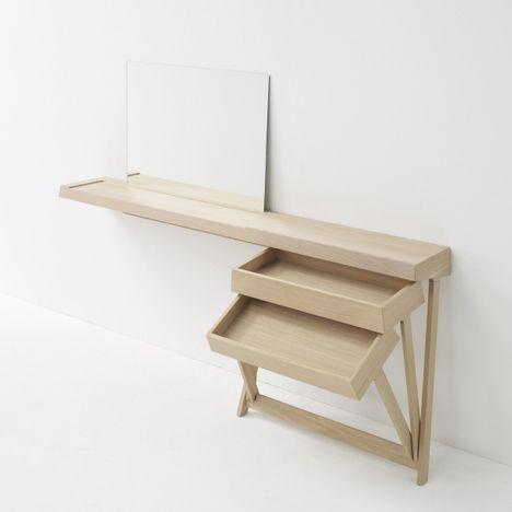 Dressing table with drawers that pivot open rather than slide