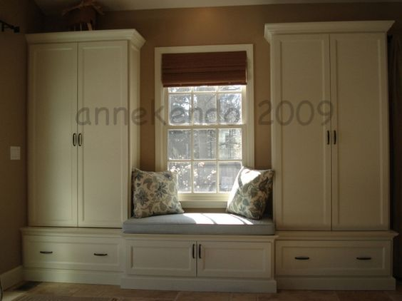 Built ins around window great alternative to the norm for Window side seating
