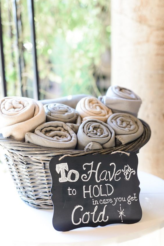 """Blankets in a basket for guest, """"To have and to hold in case you get cold"""" during their December winter ceremony 