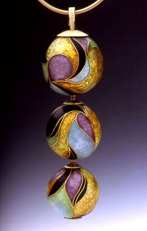Erica Druin Enamels.  From the article pictured on her site it appears as through Erica is a self taught jewelry maker who's mother's work in enamel encouraged her own.: