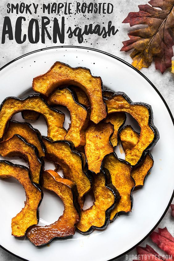 Smoky Maple Roasted Acorn Squash is an easy but elegant side dish that highlights fall produce. Easy enough for a week day, pretty enough for the holidays! Budgetbytes.com #sidedish #vegan