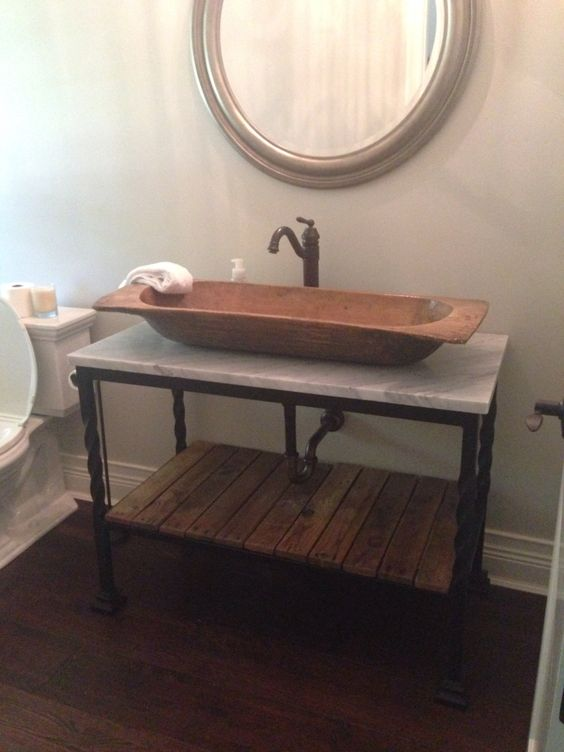 100 year old dough bowl made in to powder Room vessel sink, designed hand-forged iron vanity, Italian marble vanity top, repurposed pallete wood bottom shelf