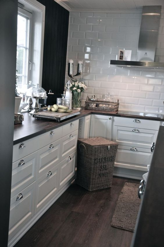 Love the white cabinets with silver. The shiny white tiles & the wood countertop: