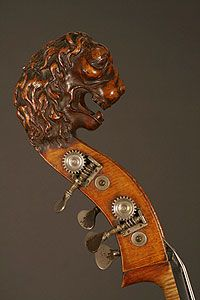 This beautiful lion lives on an antique French upright bass. Talk about fierce!