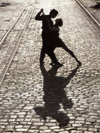 """The tango may end, but passion's fire blazes on in """"The Last Dance."""" The romantic final pose of two silhouetted tango dancers is imparted with a sense of eternity by surrounding train tracks which extend into infinity. Elongated shadows cast upon quaint cobblestones also give a boundless sense of love's ability to spontaneously ignite and endure anywhere."""