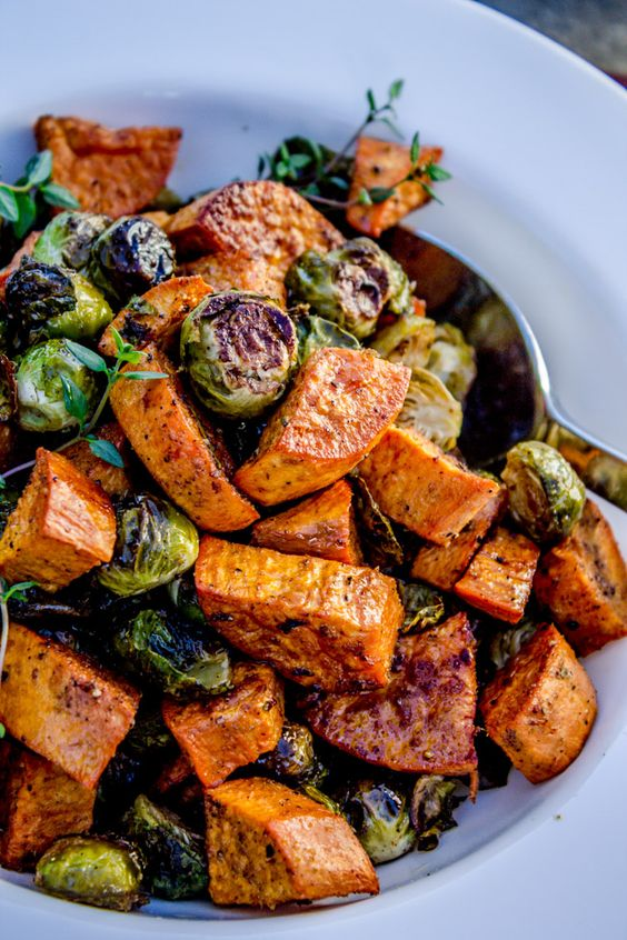 Roasted Sweet Potatoes and Brussels Sprouts: sweet potato, brussels sprouts (trimmed), 2 garlics, oil, 1 t cumin, salt & pepper, red wine vinegar. Roast at 205C 40-45 minutes.