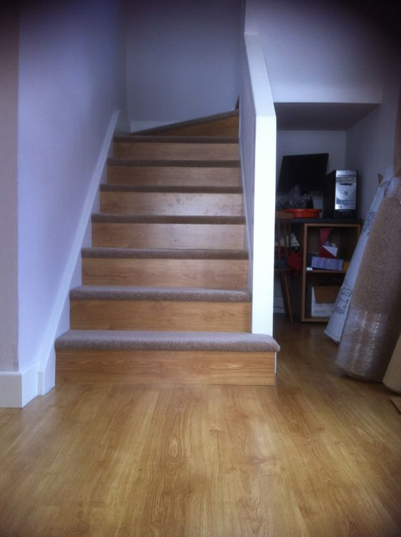 Our diy staircase using leftover laminate flooring on the for Diy laminate flooring