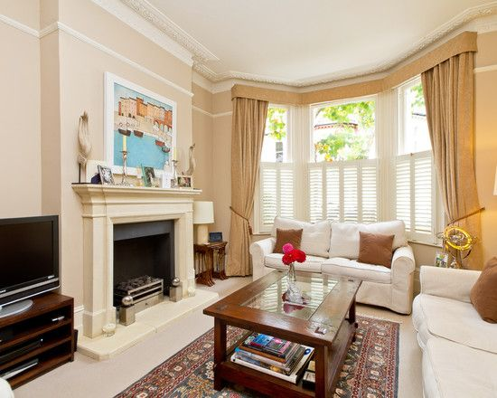 Living room plantation shutters design pictures remodel for Bay window living room ideas