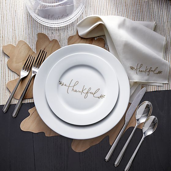 A graceful message of gratitude by artist Kelly Ventura gilds this versatile Thanksgiving accent plate in gleaming gold metallic handwriting with a botanical flourish. Broad-rimmed white porcelain plate coordinates with the Thankful platter and place cards, sold separately.