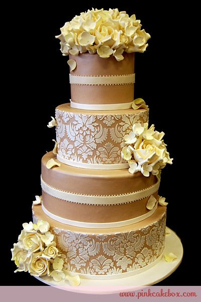 Champagne colored fondant with cascading white roses and hydrangeas