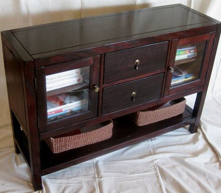 Bustom designed and built, solid mahogany wood console wtih spacious drawers, glass inset cabinet doors, and open shelf for even more storage room, by Borders Woodworks of Jackonville, Florida.