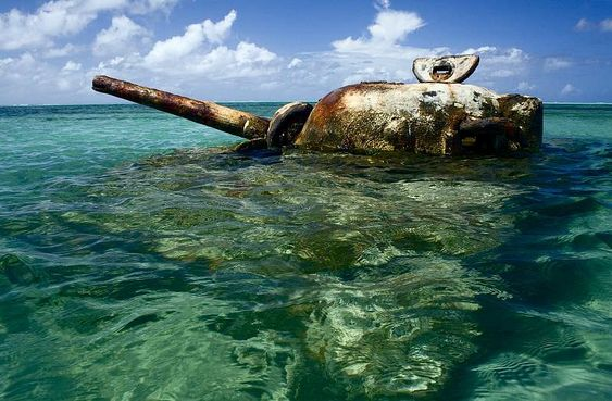 WWII Tank left from the war that sits under water in the crystal clear lagoon. #skup #metali #kolorowych
