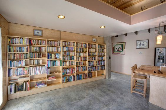 When fully closed, they form a bookcase wall in the living room.