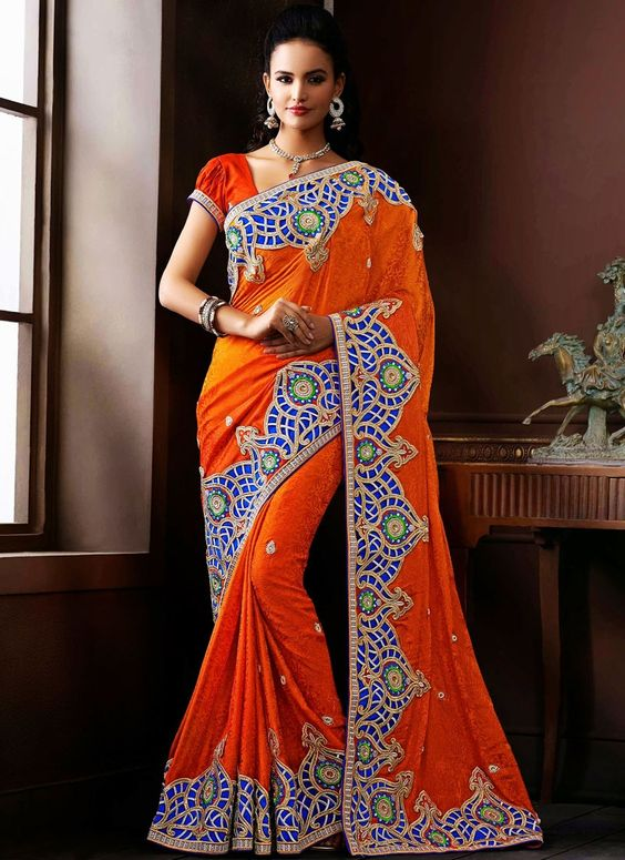 http://www.sareebuzz.in/sarees/modern-orange-jacquard-designer-saree-5463  Modern Orange Jacquard Designer Saree  Color :Orange  Occasion :Festival Reception  Fabric :Jacquard  Work :Embroidered Beads Item Code: :5463  For Inquiry Or Any Query Related To Product, Contact :- +91 9974 111 222
