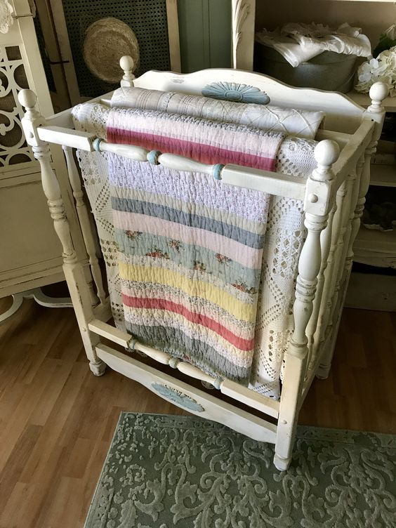 A new quilt rack from a repurposed crib.